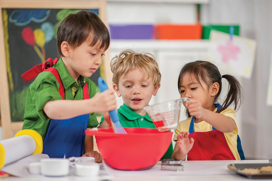 Kids mixing ingredients in a bowl