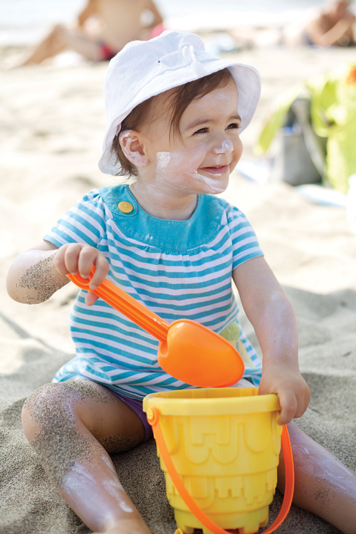 Child playing in the sand